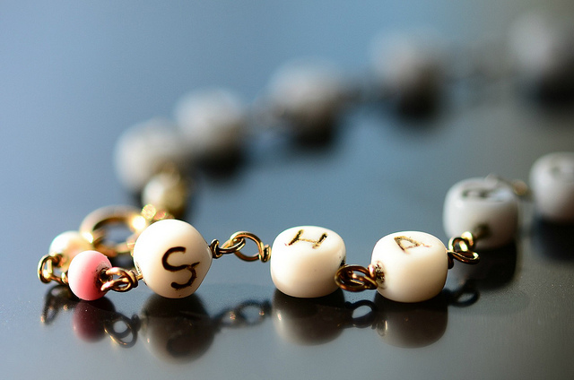 A bracelet with lettered beads